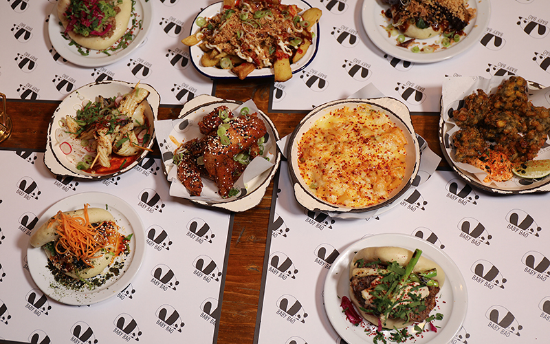 Overhead shot of Baby Bao dishes on table