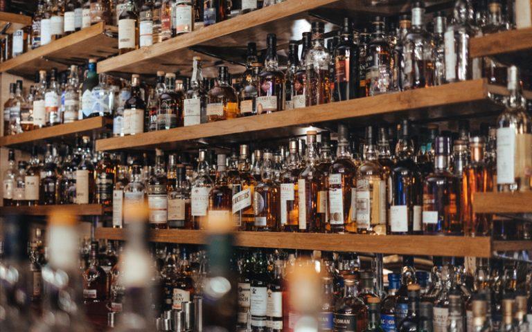 assorted-color bottle lot on shelf
