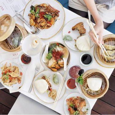Overhead shot of food on table at Uli London