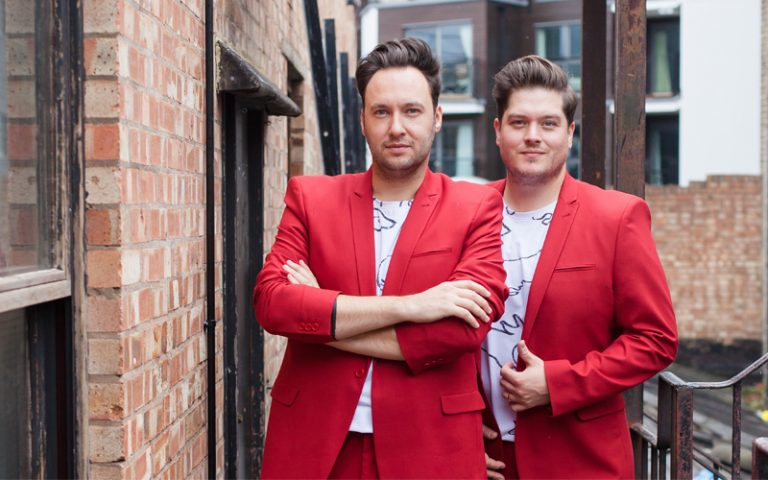 Two guys in red suits
