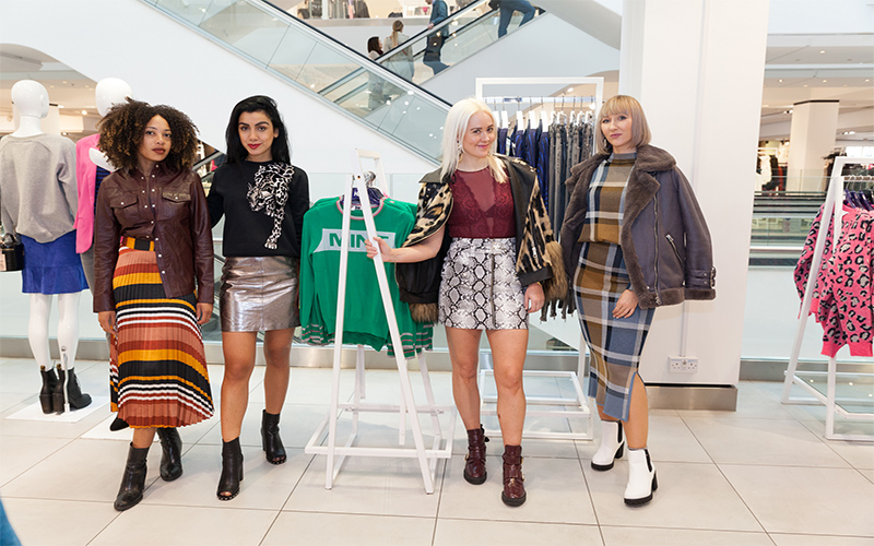 Girls standing in a department store looking fashionable