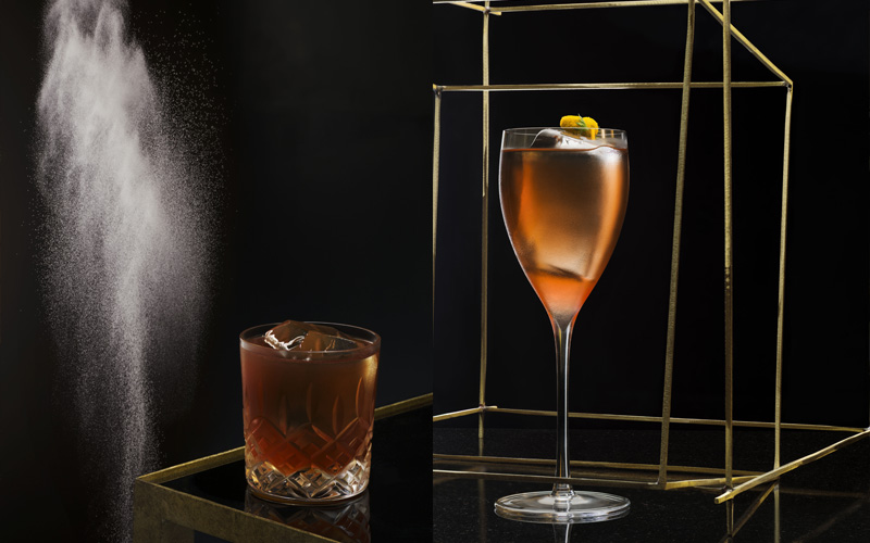 Cocktails against a dark back backdrop